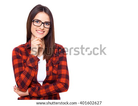 Great idea. Young attractive woman keeping hand on chin and looking on camera with smile while standing against white background - stock photo