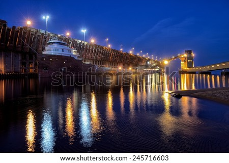 Great Lakes Freighter at port in Marquette, Michigan  - stock photo
