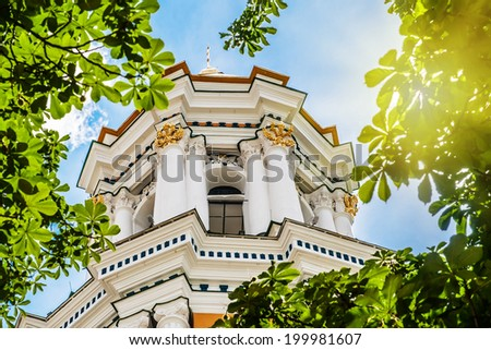 Great Lavra Bell Tower in green chestnut foliage, Kyiv, Ukraine - stock photo