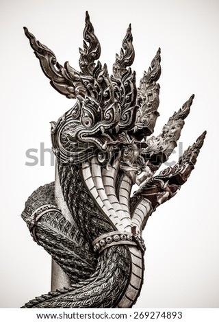 Great Naga serpent in an ancient temple of Thailand in isolated background with film grain style  - stock photo