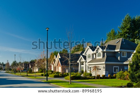 Great neighborhood. A homes  in suburbs at fall time in the north America - stock photo