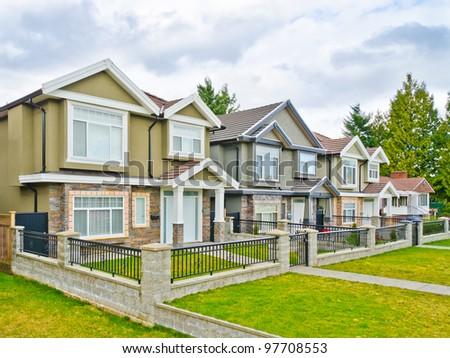 Great neighborhood. Homes in a suburb at Fall in Vancouver, Canada. - stock photo
