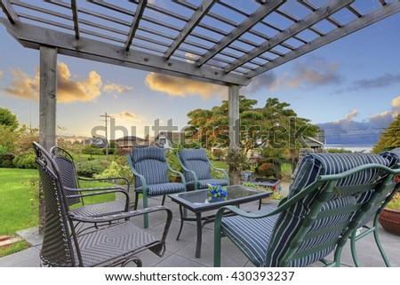 Great neighborhood with Cozy garden gazebo summer garden and chairs, - stock photo