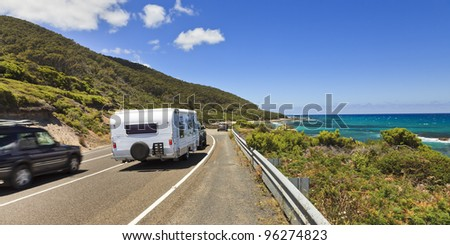 Great ocean road highway with lanes and cars passing near South ocean in Australia, Victoria, sunny summer day - stock photo