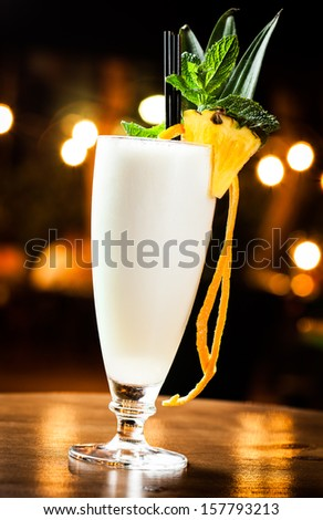 Great pina colada cocktail in a night pub. - stock photo