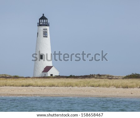 Great Point Lighthouse is located at the northern most point of the island, marking the Atlantic and Nantucket sound. - stock photo