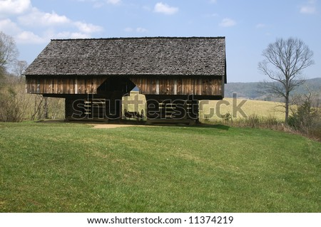 Great Smoky Mountains National Park Double Cantilever Barn on the Tipton Homestead in Cades Cove Horizontal - stock photo