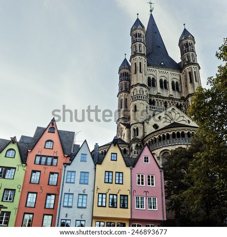 Great St. Martin Churchand and colorful houses of Cologne. Cologne, North Rhine-Westphalia, Germany,   - stock photo