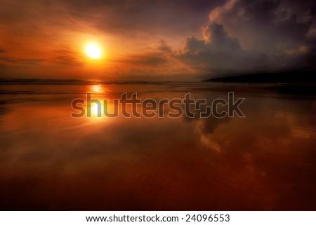 Great sunset on tropical beach. Andaman sea. Phuket island. Kingdom Thailand - stock photo