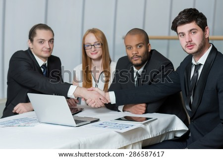 Great team business result. Team of  confident and motivated business professionals working on the project. All are wearing formal suits. Office business concept - stock photo