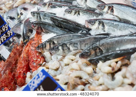 Great variety of fish and seafood on market display - stock photo