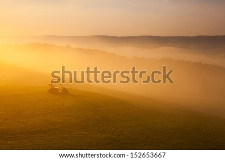 Great view at the beautiful golf course with the green golf cart. - stock photo