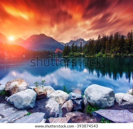 Great view of the lake under a red sky. Dramatic unusual scene. Location famous resort National Park High Tatra, Strbske pleso, Slovakia, Europe. Artistic picture. Beauty world. Warm toning effect. - stock photo