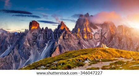 Great view of the top Cadini di Misurina range in National Park Tre Cime di Lavaredo. Dolomites, South Tyrol. Location Auronzo, Italy, Europe. Dramatic unusual scene. Beauty world. - stock photo