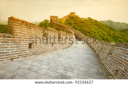 Great Wall of China in warm sunset light - stock photo