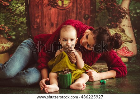 great young  mother hugging  her wonderful baby - stock photo