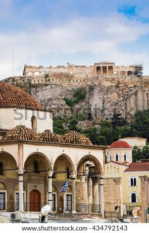 Greece, Athens, Acropolis. View of the Acropolis from the Monastiraki Square, Athens historical attractions and the Parthenon temple. - stock photo