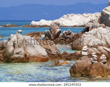 Greece beach, paradise bay untouched nature abstract archipelago in seashore with rocks in water on peninsula Halkidiki, Greece,  relaxation landscape viewpoint for design postcard and calendar - stock photo