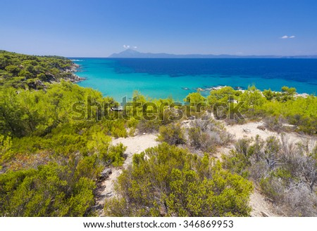 Greece beach, paradise bay untouched unique nature abstract archipelago on peninsula Chalkidiki, Greece,  three fingers Sithonia, Atos, Kassandra. Relaxation landscape for design postcard and calendar - stock photo