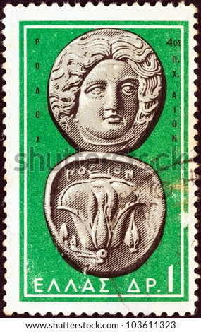 "GREECE - CIRCA 1963: A stamp printed in Greece from the ""Ancient Greek Coins"" issue shows a coin from Rhodes 4th century B.C. (Helios and rose), circa 1963. - stock photo"