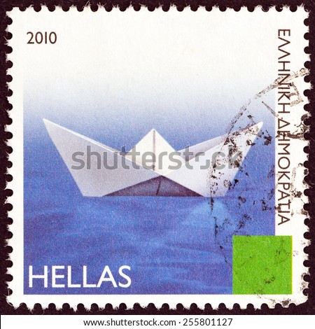 """GREECE - CIRCA 2010: A stamp printed in Greece from the """"Greek Islands"""" issue shows a paper boat, circa 2010.  - stock photo"""