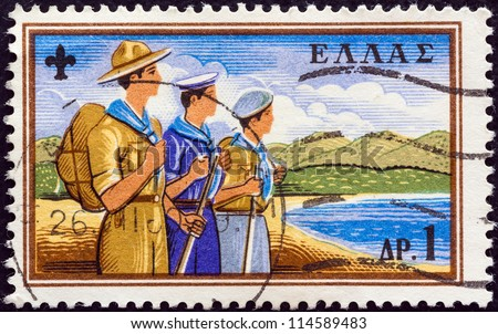 "GREECE - CIRCA 1960: A stamp printed in Greece from the ""50th anniversary of Greek Boy Scout Movement"" issue shows Scouts on beach, circa 1960. - stock photo"