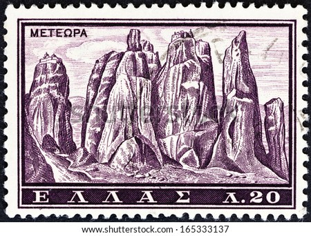 "GREECE - CIRCA 1961: A stamp printed in Greece from the ""Tourist Publicity"" issue shows the Meteora monasteries, circa 1961.  - stock photo"
