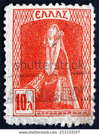 GREECE - CIRCA 1927: a stamp printed in the Greece shows Dodecanese Costume, circa 1927 - stock photo