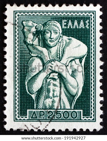 GREECE - CIRCA 1954: a stamp printed in the Greece shows Shepherd Carrying Calf, Moschophoros, the nearly Lifesize Marble Statue , of ca 570 BCE, Found on the Athenian Acropolis, circa 1954 - stock photo