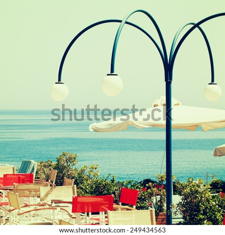 Greece coffee shop and sea, impressions of Greece - stock photo