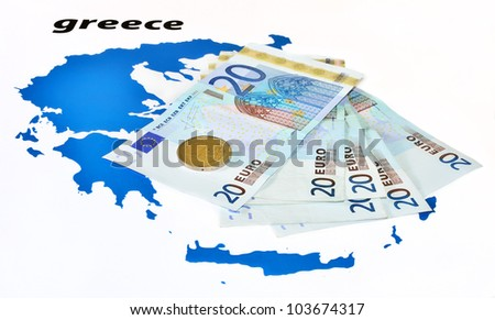 Greece crisis (euro banknotes and coin on map of Greece) - stock photo