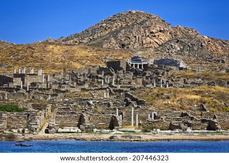 Greece. Cyclades Islands - Delos. Remains of ancient Sanctuary of Apollo, above Kynthos hill. The archaeological site of Delos is on UNESCO World Heritage List since 1990 - stock photo