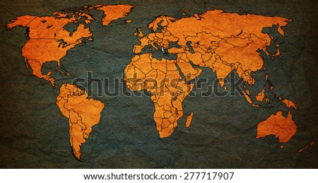 greece flag on old vintage world map with national borders - stock photo