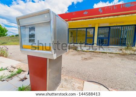 Greece ithaki island abandoned gas station pumps - stock photo