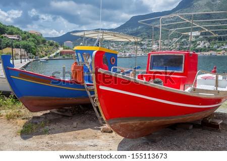 Greece ithaki island, traditional wooden fishing boats at ithaka island at summer - stock photo