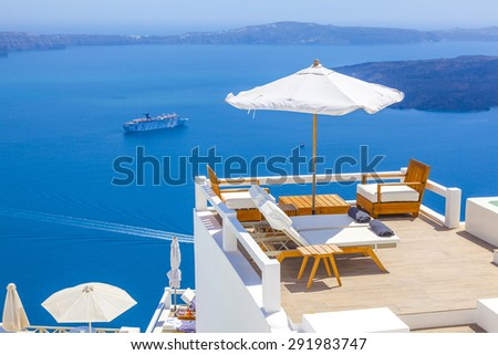 Greece Santorini island, caldera view with cruise ship on sea - stock photo