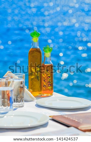 Greece Santorini island in Cyclades, traditional view of greek tavern concept - stock photo