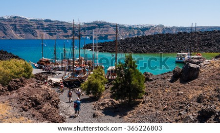 GREECE. SANTORINI - JULY 21 2015 - Tourist excursion to the volcanic crater on the Santorini island, Greece - stock photo