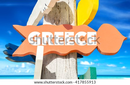 Greece signpost with beach background - stock photo