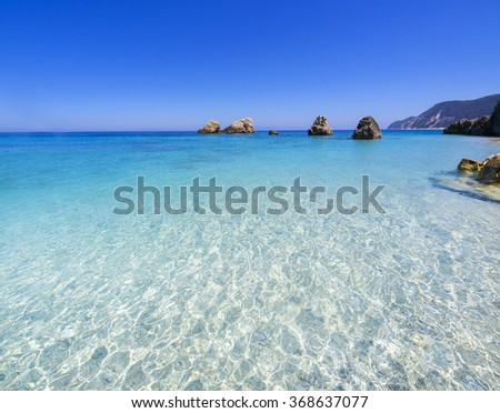 Greece wild beach Megali Petra, beautiful unique seascape untouched nature abstract archipelago in seashore with rocks in water on island Lefkada, Levkada, Leucas or Leucadia, Ionian Sea, Corfu - stock photo