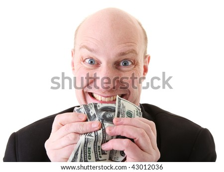 greed, businessman with money. man holding dollars in display of avarice isolated on white. - stock photo