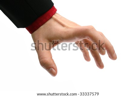 greedy hand of a business man reaching for something - stock photo