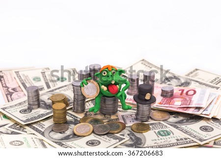 Greedy Leprechaun on the pile of money with one euro - finance concept isolated on white - stock photo