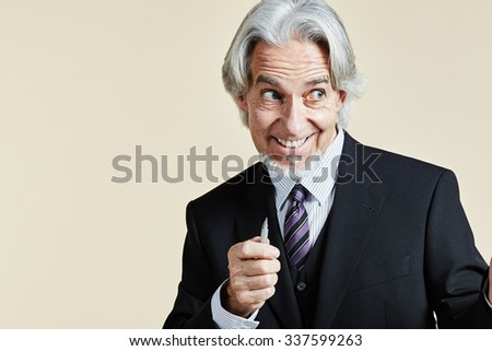 Greedy looking businessman isolated - stock photo