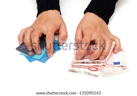 greedy woman is grabbing money and credit cards - stock photo