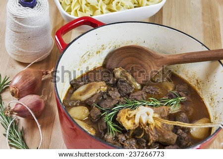 Greek Beef Stifado served with egg noodles - stock photo