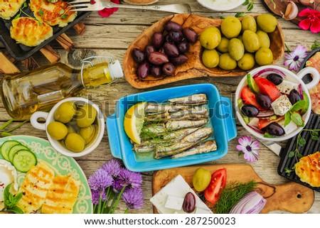 Greek cuisine dishes - feta, choriatiki, halloumi, tzatziki, sardines - stock photo