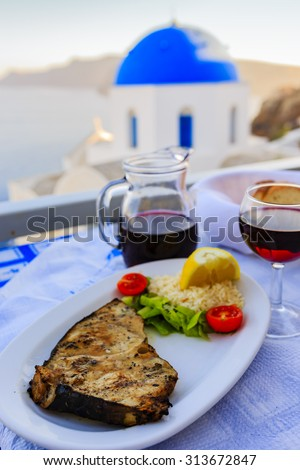 Greek cuisine - grilled swordfish, a dish - stock photo