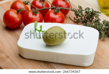 Greek Feta cheese with olive oil and thyme - stock photo