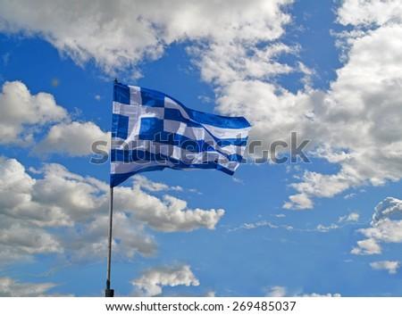 greek flag clouds crisis - stock photo